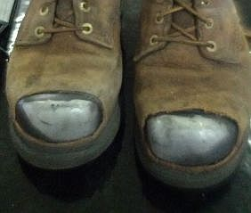 The boots may be a bit worn, but the steel toes are still intact!